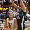 Santa Fe Indian School's Milan Schimmel, #32, goes up for two points while Hope Christian's Brielle Milford, #32, tries to defend during the first quarter at the Pueblo Pavilion Wellness Center on Friday, January 23, 2015.  Jane Phillips/The New Mexican