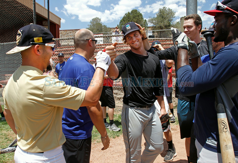 "Bisby Blue of Arizona, Daniel Aldrich,center, is high-fived after he hit 8-10 in the Pecos home run derby at Fort Marcy ballpark  on Monday, June 30, 2014.  Jane Phillips/The New Mexican  <a href=""http://tinyurl.com/ok2bzv8"">http://tinyurl.com/ok2bzv8</a>"