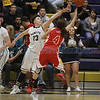 Santa Fe's Jackie Martinez, number 23, tries to block a shot by Española's Kayla Romero, number 4, during the first quarter of the Santa Fe High School vs Española High School at Santa Fe on Friday, February 28, 2014. Luis Sanchez Saturno/The New Mexican