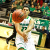 Pojoaque Valley Elks Brandon Bustos, #23, passes the ball to a teammate during the first quarter of  their game against  Bloomfield at the Ben Lujan Gymnasium on  Saturday, March 9, 2013.  Jane Phillips/The New Mexican