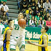 Pojoaque Valley Elks Brandon Bustos, #23, goes up for two points  while Bloomfield Bobcats Tyler Barker, #44 looks on during the first quarter of  their game  at the Ben Lujan Gymnasium on  Saturday, March 9, 2013.  Jane Phillips/The New Mexican