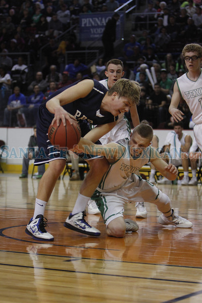 Texico's Gentry Doolittle, number 4, challenges the ball from Prep's William Lenfestey, number 33, during the second quarter of the Santa Fe Prep vs Texico High School game of the Class AA state quarterfinals at the Santa Ana Star Center on March 14, 2014. Luis Sanchez Saturno/The New Mexican