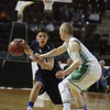 Texico's Gentry Doolittle, number 4, covers Prep's Diego Perea, number 21, during the second quarter of the Santa Fe Prep vs Texico High School game of the Class AA state quarterfinals at the Santa Ana Star Center on March 14, 2014. Luis Sanchez Saturno/The New Mexican