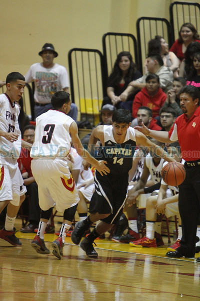 The first quarter of the Española Valley High School vs Capital High School during the district 2AAAA boys basketball championship at Española Valley on March 1, 2014. Luis Sanchez Saturno/The New Mexican