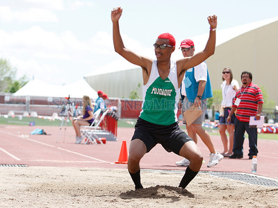 C.J. Berryman celebrates in the long jump pit as he stands up out of his last jump to win first place during State Track and Field Championships at UNM track in Albuquerque, N.M. on May 11, 2012. Photos by Natalie Guillén/The New Mexican