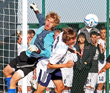 Isaiah Tyree, goal keeper for Taos Valley High School collides with Santa Fe Prep's Kevin Lowe during overtime of a boys soccer game on Nov. 4, 2010. The Griffins won in penalty kicks.  Natalie Guillén/The New Mexican