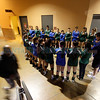 Players from St. Michael's High School and West Las Vegas High School hold hands on November 14, 2013, before their 2013 Volleyball Championship game while praying for Head Coach Mary Bustos, who passed away Wednesday morning. Luis Sánchez Saturno/The New Mexican