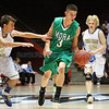 "Tim Romero (center), of Mora, breaks through (left) Brandon Gillis and (right) Tim Kraus of Mesilla Valley during a boys basketball game in the Arthur ""DINTY"" Romero Basketball Tip-Off Classic held at the Pit in Albuquerque, N.M. on Nov. 18, 2011. <br /> Natalie Guillén/The New Mexi"