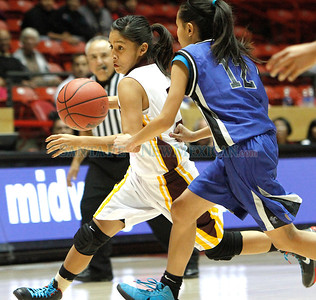 "Victoria Lovato (left), of Santa Fe Indian School, breaks past Krishia Artieda (right) of Navajo PIne during a girls basketball game at the Arthur ""DINTY"" Romero Basketball Tip-Off Classic held at the Pit in Albuquerque, N.M. on Nov. 18, 2011.  Natalie Guillén/The New Mexi"