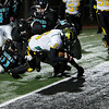 Los Alamos' Brice Van Etten, number 6, gets through a swarm of Capital defenders for the touchdown during the second quarter of the Capital High School vs Las Alamos High School football game at Capital on November 1, 2013. Luis Sánchez Saturno/The New Mexican
