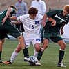 St. Michael's Sean Smith, #15 tries to keep the ball away from Hope Christian's Derek Nelson, #16 and Lucas Baca, #7 during the second half of their game at the State Boys and Girls Soccer Tournaments at APS Soccer Complex, Albuquerque on Thursday, November 8, 2013. Jane Phillips/The New Mexican