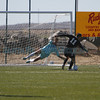 Albuquerque Academy's goal keeper, Theodore Hooker, hives as Capital's Jason Alarcon, number 11, tries to take a shot on goal during the first half of the Capital High School vs Albuquerque Academy during day 2 of the State Soccer Championship at the APS Soccer Complex in Albuquerque on November 8, 2013.  Luis Sánchez Saturno/The New Mexican