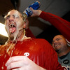 Philadelphia Phillies' Brett Myers gets a beer bath from teammate Miguel Cairo, right, in the clubhouse after the Phillies beat the Colorado Rockies 5-4 in Game 4 in a National League baseball division series in Denver on Monday, Oct. 12, 2009. (AP Photo/Jack Dempsey)