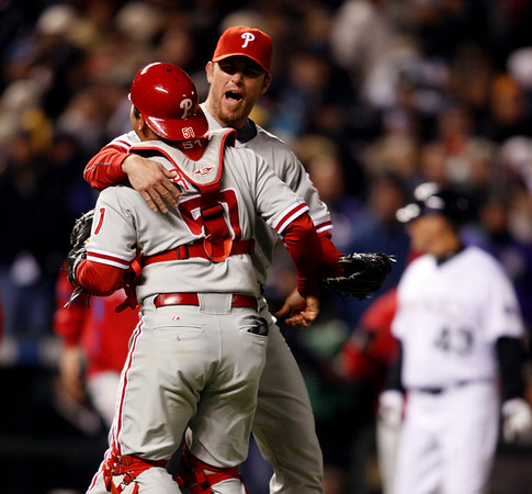 Philadelphia Phillies catcher Carlos Ruiz, left, embraces Brad Lidge as they celebrate after the Phillies beat the Colorado Rockies 5-4 in Game 4 in a National League baseball division series in Denver on Monday, Oct. 12, 2009. The Phillies advanced to the NL Championship Series against the Los Angeles Dodgers. (AP Photo/Jack Dempsey)