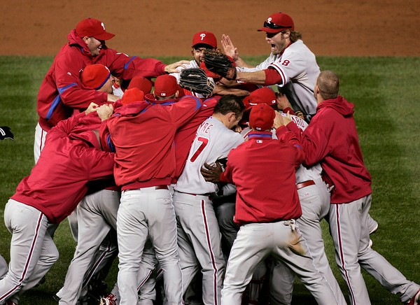 The Philadelphia Phillies celebrate after beating the Colorado Rockies 5-4 in Game 4 of a National League baseball division series in Denver on Monday, Oct. 12, 2009. The Phillies advanced to the NL Championship Series and will face the Los Angeles Dodgers. (AP Photo/Will Powers)