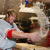 Philadelphia Phillies' Jayson Werth sprays teammates in the clubhouse as they celebrate their 5-4 win over the Colorado Rockies in Game 4 in a National League baseball division series in Denver on Monday, Oct. 12, 2009. The Philadelphia Phillies will face the Los Angeles Dodgers in the NL Championship Series. (AP Photo/Jack Dempsey)