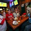 Terri Funk, Terry Funk, Linda Wacerman, and John Scapellati, from left, react while watching, at a sport bar in Philadelphia, the Philadelphia Phillies play the Colorado Rockies in Game 4 of the National League division series Monday, Oct. 12, 2009, in Denver. The Phillies won 5-4. (AP Photo/Joseph Kaczmarek)