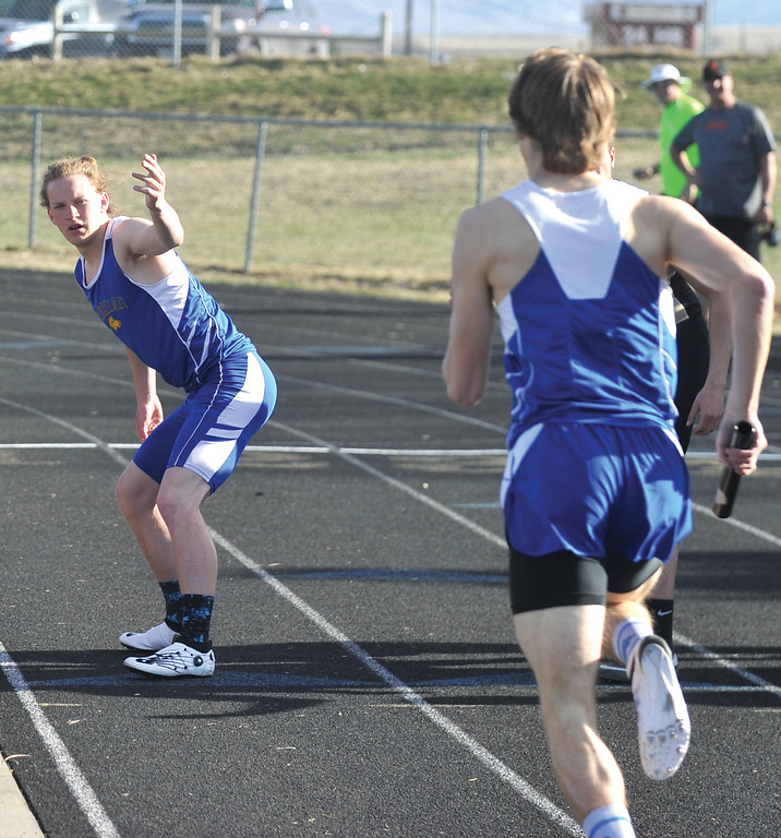 Bud Denega | The Sheridan Press<br /> Alec Riegert preps to take the baton from Tymer Goss in the 1,600-meter relay during the Gary Benson Invitational Monday.