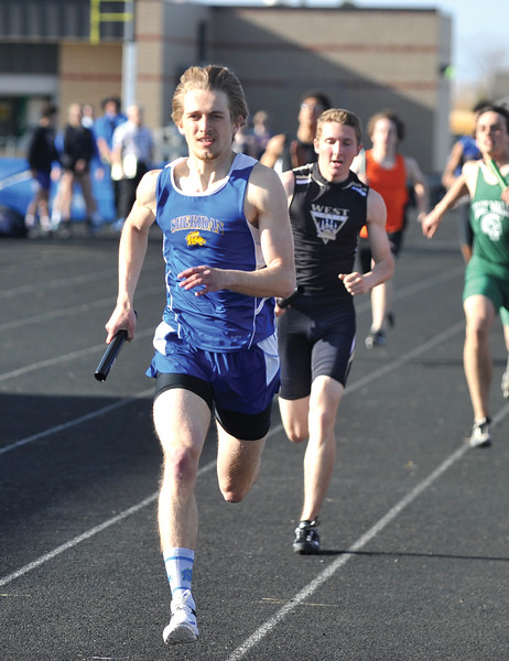 Bud Denega | The Sheridan Press<br /> Tymer Goss ran legs of the victorious 3,200- and 1,600-meter relays at the Gary Benson Invitational Monday.