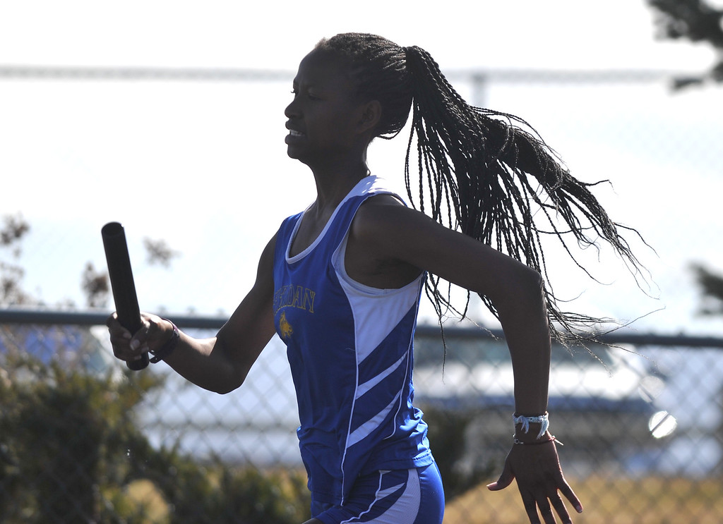 Bud Denega | The Sheridan Press<br /> Taemalle Lawson competes in the 400-meter relay during the Gary Benson Invitational Monday.