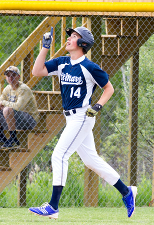 Record-Eagle/Brett A. Sommers <br /> <br /> Gaylord St. Mary third baseman Josh Nowicki points to the sky after hitting his first home run of the season during Tuesday's Division IV baseball quarterfinal against Norway at St. Elizabeth Ann Seton Middle School in Traverse City. The gesture was made in rememberance of a friend who passed away. The Snowbirds won 6-2.