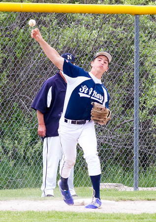 Record-Eagle/Brett A. Sommers <br /> <br /> Gaylord St. Mary third baseman Josh Nowicki makes a long throw to first during Tuesday's Division IV baseball quarterfinal against Norway at St. Elizabeth Ann Seton Middle School in Traverse City. The Snowbirds won 6-2.