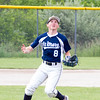 Record-Eagle/Brett A. Sommers <br /> <br /> Gaylord St. Mary second baseman Drew Long tracks a deflected ball before making an outstanding play for the out during Tuesday's Division IV baseball quarterfinal against Norway at St. Elizabeth Ann Seton Middle School in Traverse City. The Snowbirds won 6-2.