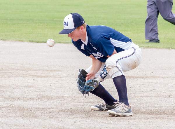 Record-Eagle/Brett A. Sommers <br /> <br /> Gaylord St. Mary second baseman Drew Long blocks a ground ball during Tuesday's Division IV baseball quarterfinal against Norway at St. Elizabeth Ann Seton Middle School in Traverse City. The Snowbirds won 6-2.
