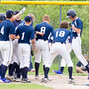 Record-Eagle/Brett A. Sommers <br /> <br /> Gaylord St. Mary third baseman Josh Nowicki is welcomed to home plate by his teammates after hitting a home run during Tuesday's Division IV baseball quarterfinal against Norway at St. Elizabeth Ann Seton Middle School in Traverse City. The Snowbirds won 6-2.