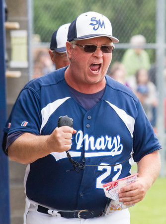 Record-Eagle/Brett A. Sommers <br /> <br /> Gaylord St. Mary assistant coach Tim Wiltse celebrates a bases-loaded strike out in the fifth inning during Tuesday's Division IV baseball quarterfinal against Norway at St. Elizabeth Ann Seton Middle School in Traverse City. The Snowbirds won 6-2.