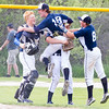 Record-Eagle/Brett A. Sommers <br /> <br /> Gaylord St. Mary pitcher Nick Torsky is lifted up by teammates Gage Andrews (left) and Drew Long (right) following Tuesday's Division IV baseball quarterfinal against Norway at St. Elizabeth Ann Seton Middle School in Traverse City. The Snowbirds won 6-2.