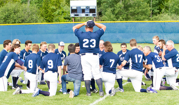 Record-Eagle/Brett A. Sommers <br /> <br /> Gaylord St. Mary forms a prayer circle following Tuesday's Division IV baseball quarterfinal win against Norway at St. Elizabeth Ann Seton Middle School in Traverse City. The Snowbirds won 6-2.