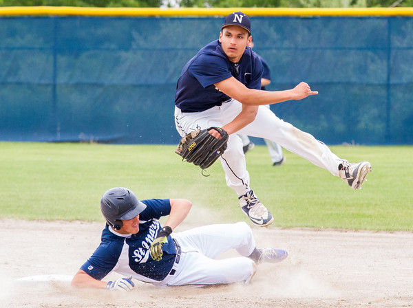 Record-Eagle/Brett A. Sommers <br /> <br /> Norway shortstop Bryce Grayvold turns a double play over Gaylord St. Mary's sliding Billy Koenig during Tuesday's Division IV baseball quarterfinal against Norway at St. Elizabeth Ann Seton Middle School in Traverse City. The Snowbirds won 6-2.#5 Norway