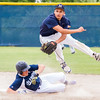 Record-Eagle/Brett A. Sommers <br /> <br /> Norway shortstop Bryce Grayvold turns a double play over Gaylord St. Mary's sliding Billy Koenig during Tuesday's Division IV baseball quarterfinal against Norway at St. Elizabeth Ann Seton Middle School in Traverse City. The Snowbirds won 6-2.#5 Norway#?? GSM