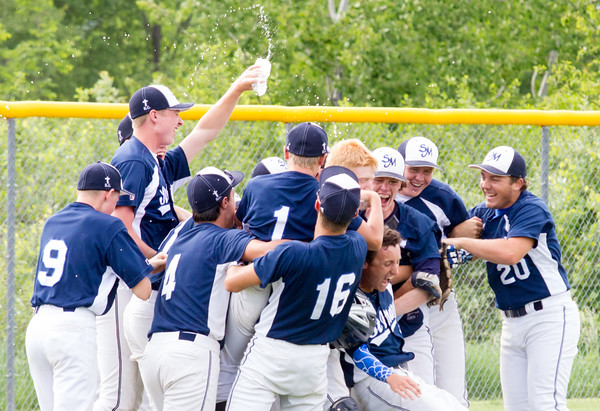 Record-Eagle/Brett A. Sommers <br /> <br /> Gaylord St. Mary celebrates advancing to the state semifinals following Tuesday's Division IV baseball quarterfinal win against Norway at St. Elizabeth Ann Seton Middle School in Traverse City. The Snowbirds won 6-2.