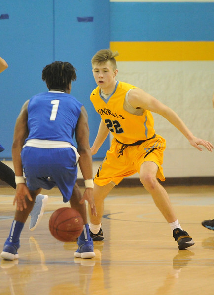 Justin Sheely | The Sheridan Press<br /> Sheridan's Keenan Dowell guards Little Big Horn College's Yberson Augustin at the Bruce Hoffman Golden Dome Saturday, March 3, 2018. The Generals won 109-73, advance to the Region IX quarterfinals.