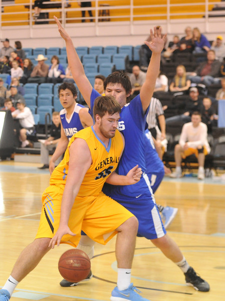 Justin Sheely | The Sheridan Press<br /> Sheridan's Trace Murphey, front, dribbles against Little Big Horn College at the Bruce Hoffman Golden Dome Saturday, March 3, 2018. The Generals won 109-73, advance to the Region IX quarterfinals.