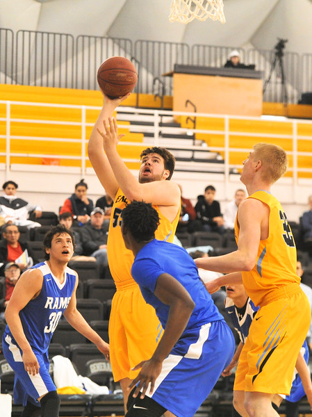 Justin Sheely | The Sheridan Press<br /> Sheridan's Trace Murphey, center, shoots for two against Little Big Horn College at the Bruce Hoffman Golden Dome Saturday, March 3, 2018. The Generals won 109-73, advance to the Region IX quarterfinals.