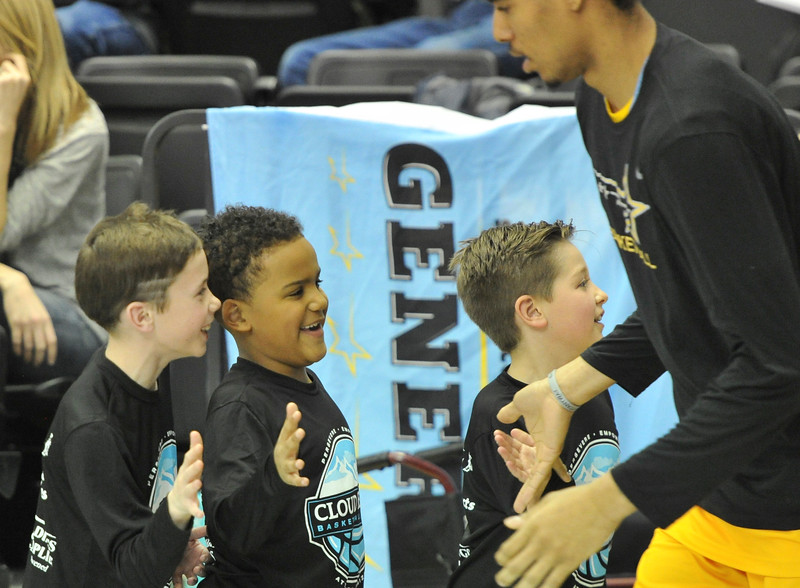 Justin Sheely | The Sheridan Press<br /> <br /> Young fans, from left, Finn McFadden, Darian Proctor and Dominic Destafano welcome the Generals at they enter the court during the Sheridan men's rivalry game against Gillette College at the Bruce Hoffman Golden Dome Saturday, Feb. 17, 2018. The Generals beat the Pronghorns 85-70.