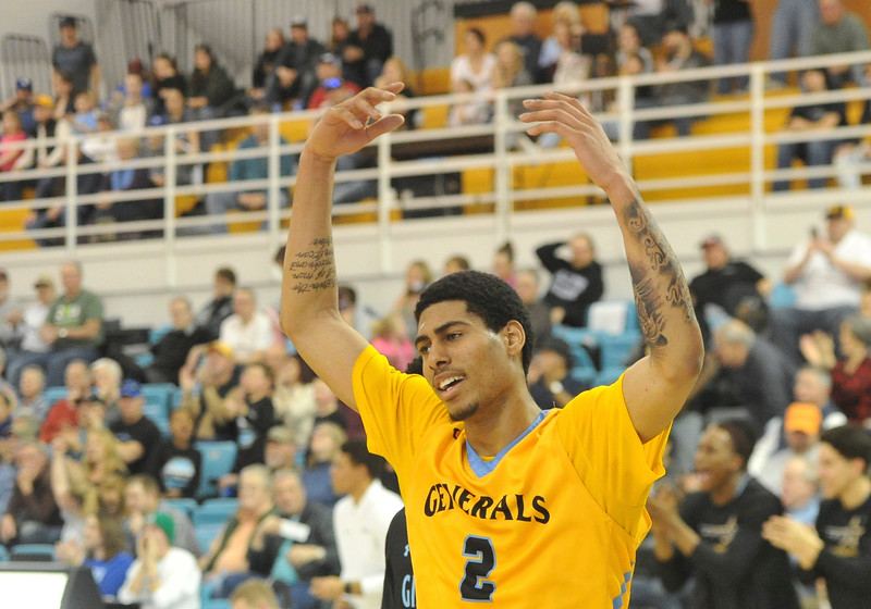 Justin Sheely | The Sheridan Press<br /> <br /> Sheridan's AJ Bramah waves to the crowd at the Bruce Hoffman Golden Dome Saturday, Feb. 17, 2018. The Generals beat the Pronghorns 85-70.