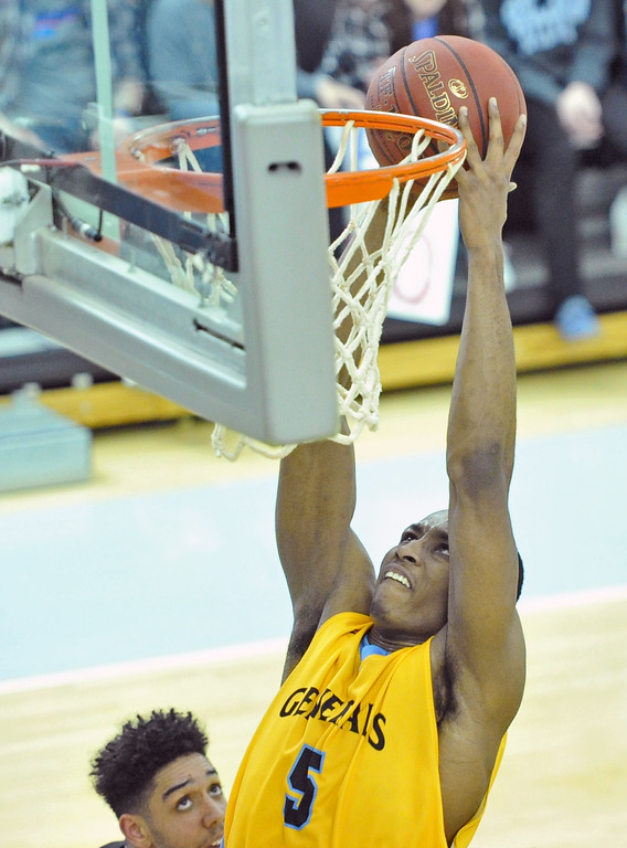 Mike Pruden | The Sheridan Press<br /> Camron Reece reaches for a two-hand dunk against Western Wyoming at the Bruce Hoffman Golden Dome Wednesday, Feb. 7, 2018.