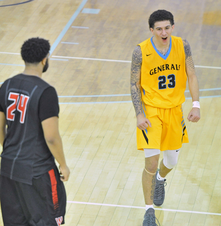 Mike Pruden | The Sheridan Press<br /> Channel Banks celebrates Sheridan College's win over Western Wyoming at the Bruce Hoffman Golden Dome Wednesday, Feb. 7, 2018.