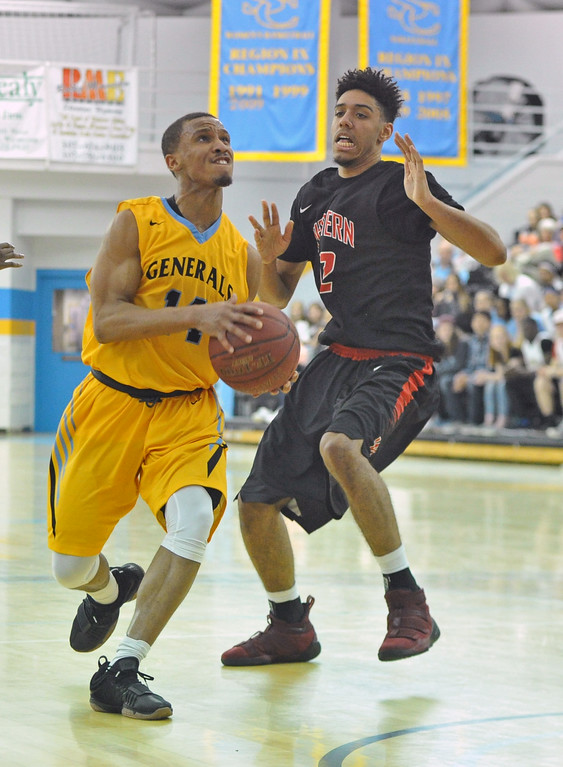 Mike Pruden | The Sheridan Press<br /> Josh Bagley, left, drives past Western Wyoming's Tyrees Sidberry in the first half of Sheridan College's 76-71 victory at the Bruce Hoffman Golden Dome Wednesday, Feb. 7, 2018.