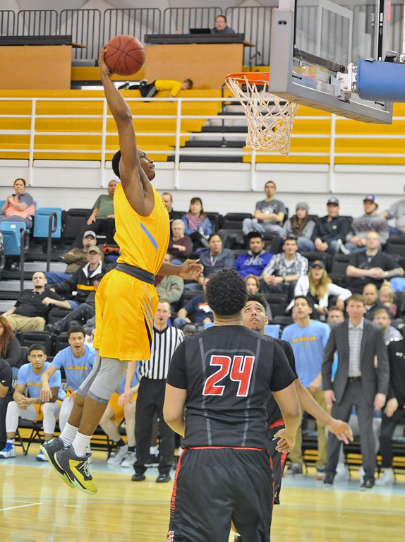 Mike Pruden | The Sheridan Press<br /> Camron Reece throws down a dunk against Western Wyoming at the Bruce Hoffman Golden Dome Wednesday, Feb. 7, 2018.