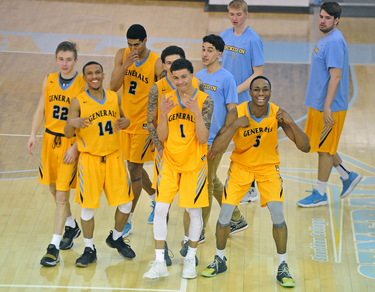 Mike Pruden | The Sheridan Press<br /> Members of the Sheridan College men's basketball team celebrate after avenging an earlier loss to Western Wyoming at the Bruce Hoffman Golden Dome Wednesday, Feb. 7, 2018.