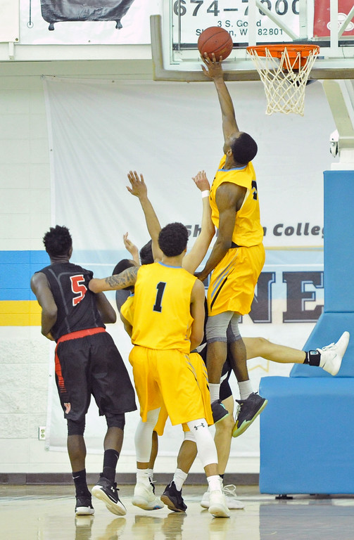 Mike Pruden | The Sheridan Press<br /> Sheridan College's Cam Reece rises from a cluster of players to pin a shot to the backboard at the Bruce Hoffman Golden Dome Wednesday, Feb. 7, 2018.