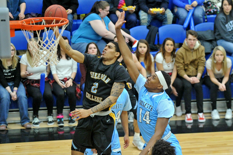 Mike Pruden | The Sheridan Press<br /> Sheridan College's AJ Bramah (2) lays the ball up past Gillette College's Edwin Jeudy at the Pronghorn Center in Gillette Wednesday, Jan. 24, 2018.