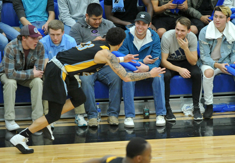 Mike Pruden | The Sheridan Press<br /> Sheridan College's Channel Banks lets the Gillette College student section know he just buried a 3-pointer at the Pronghorn Center in Gillette Wednesday, Jan 24, 2018.