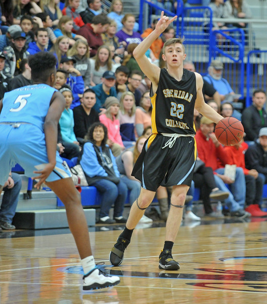 Sheridan College point guard Keenan Dowell calls out a play at the Pronghorn Center in Gillette Wednesday, Jan 24, 2018.
