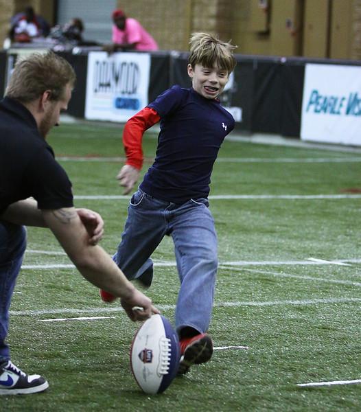 Young Boy Kicking